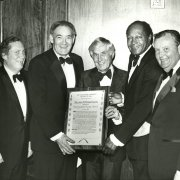 Judge Stephen Reinhardt, Councilman John Ferraro, Mayor Bradley and Southwestern President Paul Wildman present the Distinguished Citizen Award to William Robertson (center), Secretary-Treasurer of the American Federation of Labor-Congress of Industrial Organizations (AFL-CIO), during the 1980 Tom Bradley Scholarship Fund Dinner.
