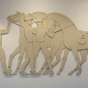 Wooden polo ponies bas relief